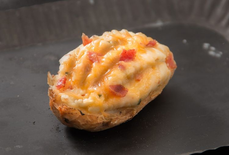 ... Loaded Twice Baked Potato with Bacon, Sour Cream & Cheddar Cheese